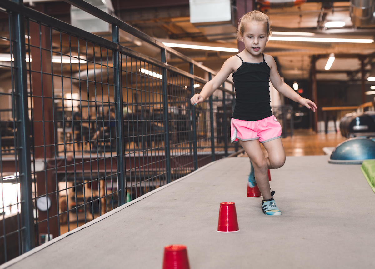 young girl on an agility course