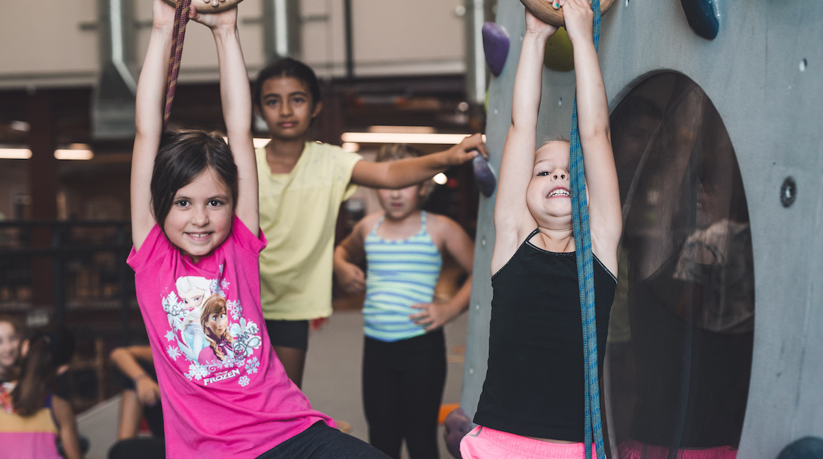 young girls doing an agility exercise during climbing camp