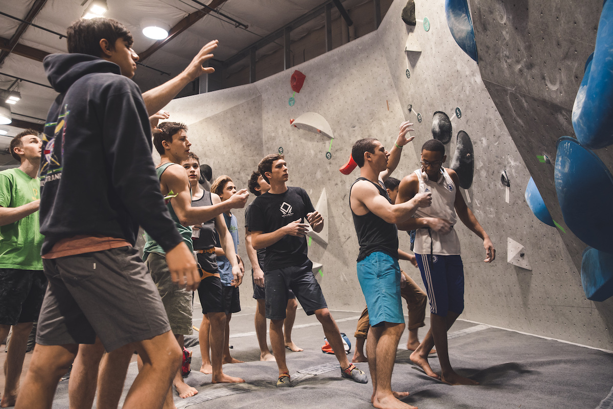 men analyzing bouldering routes