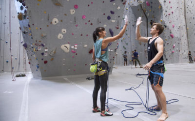 male and female climber giving each other a high five