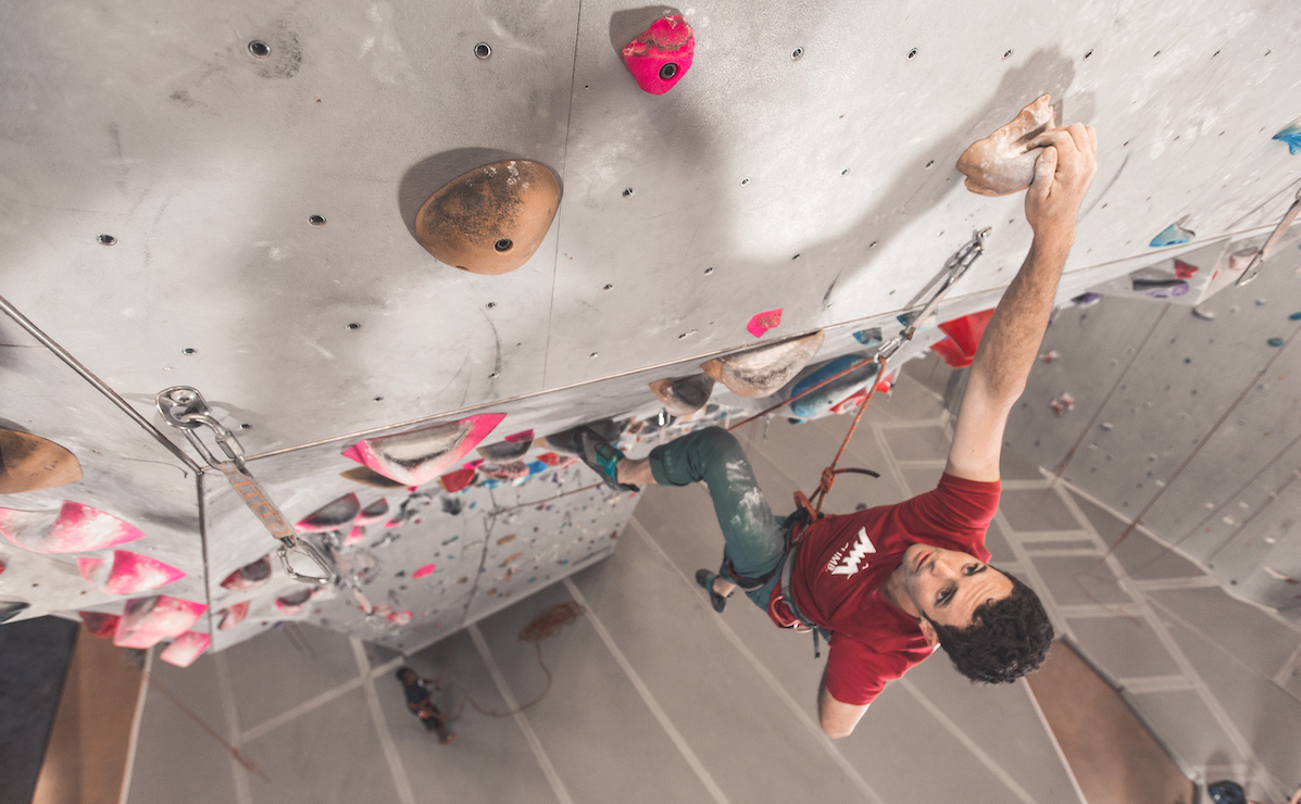 man lead climbing