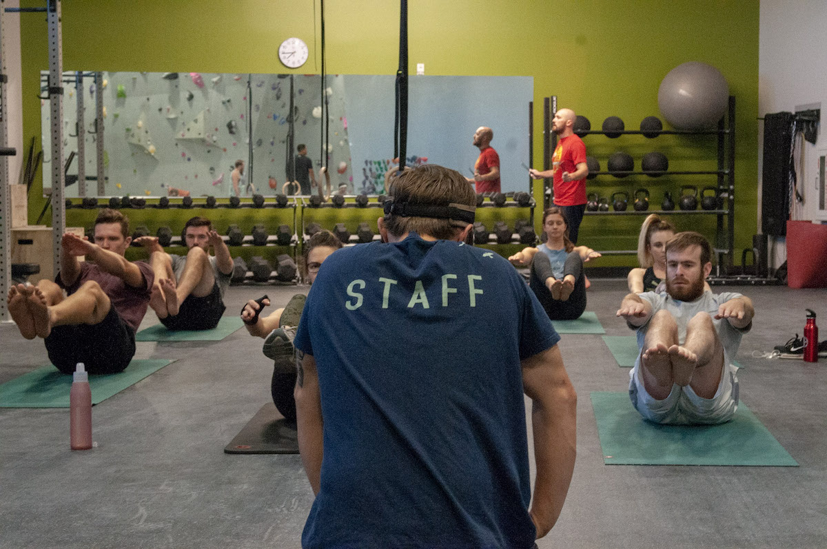 Instructor leads a core conditioning class