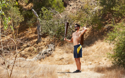 john parker using indian clubs on a hiking trail