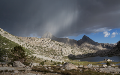 rainstorm above jagged mountains